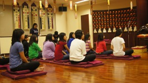 Students were listening to   a brief lecture on Zen Meditation.